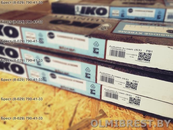 Фото пачки гибкой черепицы IKO Cambridge xtreme 53 цвет Двойной коричневый и OSB-3 плиты
